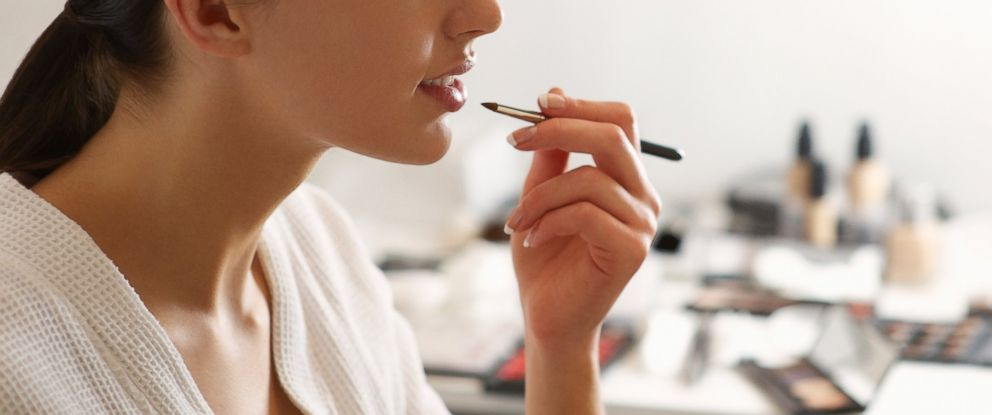 PHOTO: A woman is applying makeup in this stock image.