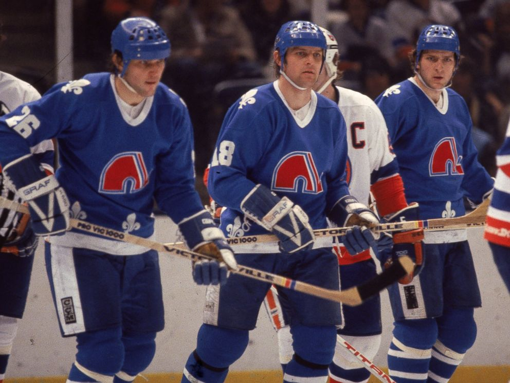 PHOTO: Czech ice hockey playing brothers, Peter Stastny (L)), Marian Stastny (C), and Anton Stastny, of the Quebec Nordiques are seen on the ice in a game against the New York Islanders at Nassau Coliseum in Uniondale, New York, early 1980s.