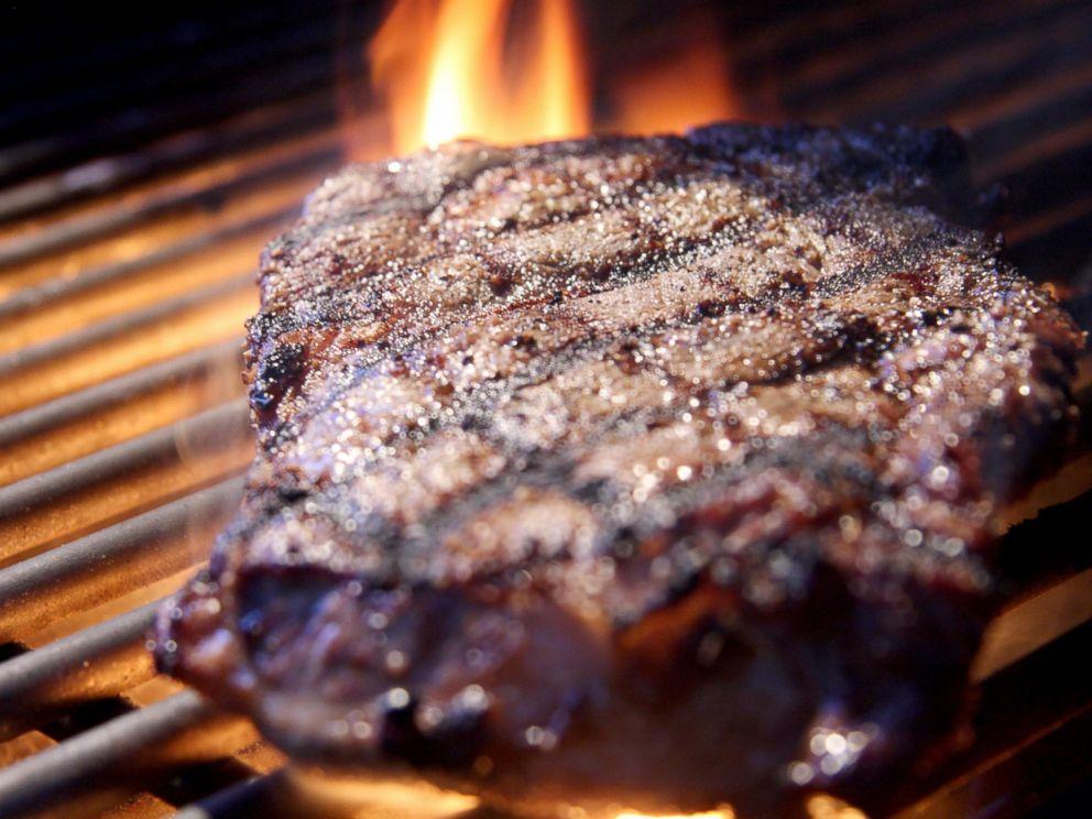 PHOTO: Rib eye steak on a grill.