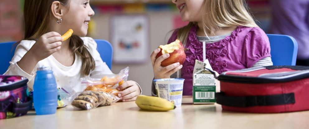 PHOTO: Two students eat lunch.