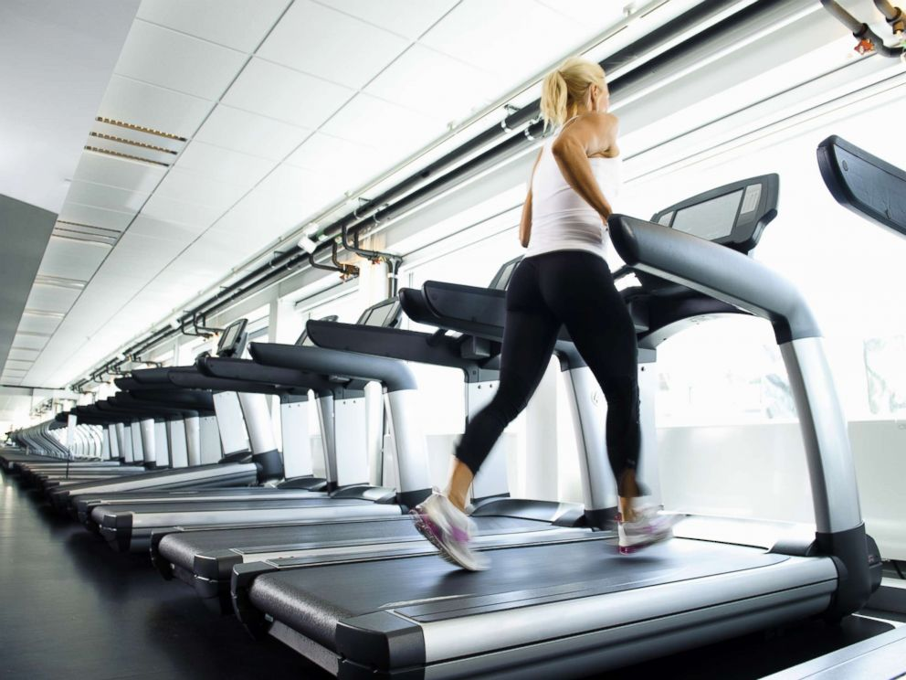 PHOTO: A woman works out on a treadmill.