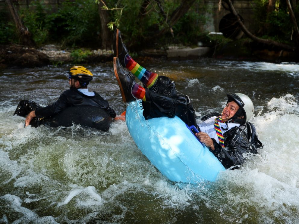 PHOTO: Jeff Kagan, left, is the founder of the seventh annual Boulders Tube to Work Day, July 15, 2014. Around 40 participants took their tubes down Boulder Creek on their way to work.
