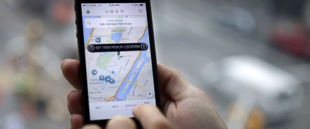 PHOTO: The Uber Technologies Inc. car service application is demonstrated for a photograph on an Apple Inc. iPhone in New York, Aug. 6, 2014.