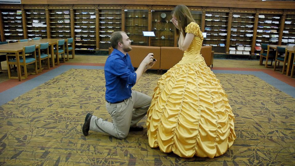 "Joel Lynch pulled off a magical ""Beauty and the Beast"" proposal for Cara Szymanski complete with Belle's yellow gown."