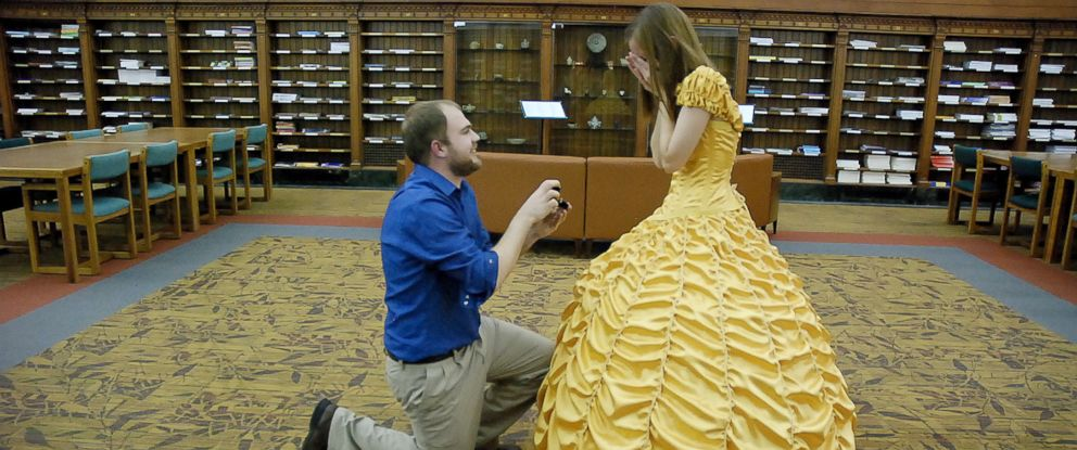 "PHOTO: Joel Lynch pulled off a magical ""Beauty and the Beast"" proposal for Cara Szymanski complete with Belles yellow gown."