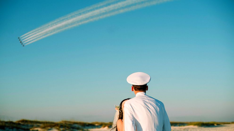 Rachel and Chandler Mills were surprised by a Blue Angels flyover at their wedding in Pensacola, Florida.