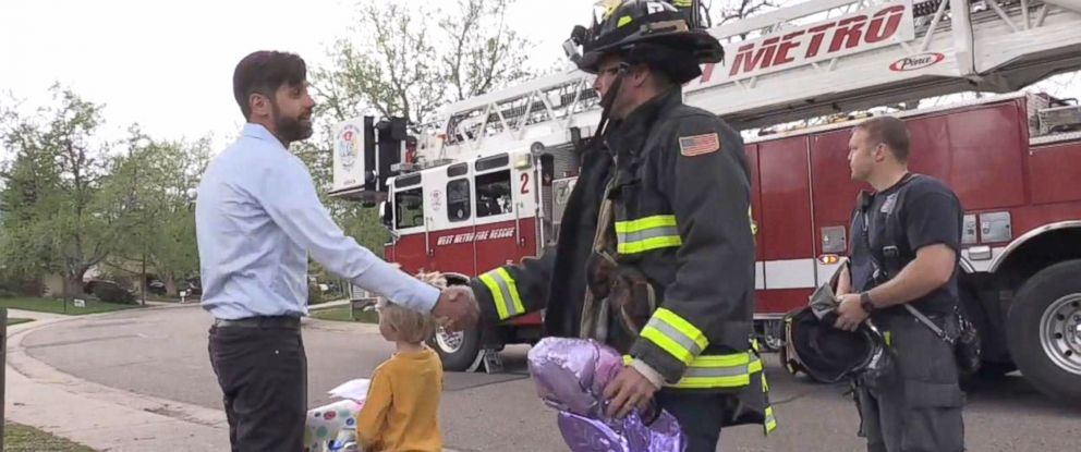 """PHOTO: Firefighters of West Metro Fire Rescue in Lakewood, Colorado, helped a boy retrieve his balloon from a tree that he sent up to """"heaven"""" for his mom."""