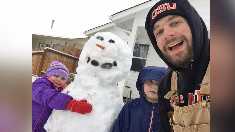 Clint Edwards seen in an undated photo building a snowman with two of his three children, Tristan, 10 and Norah, 7.