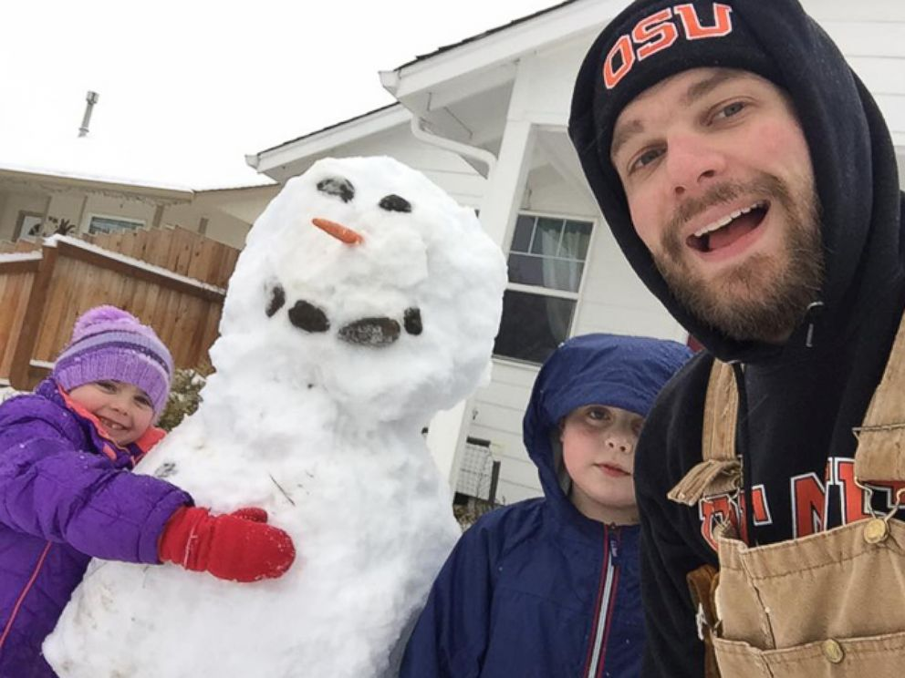PHOTO: Clint Edwards seen in an undated photo building a snowman with two of his three children, Tristan, 10 and Norah, 7.