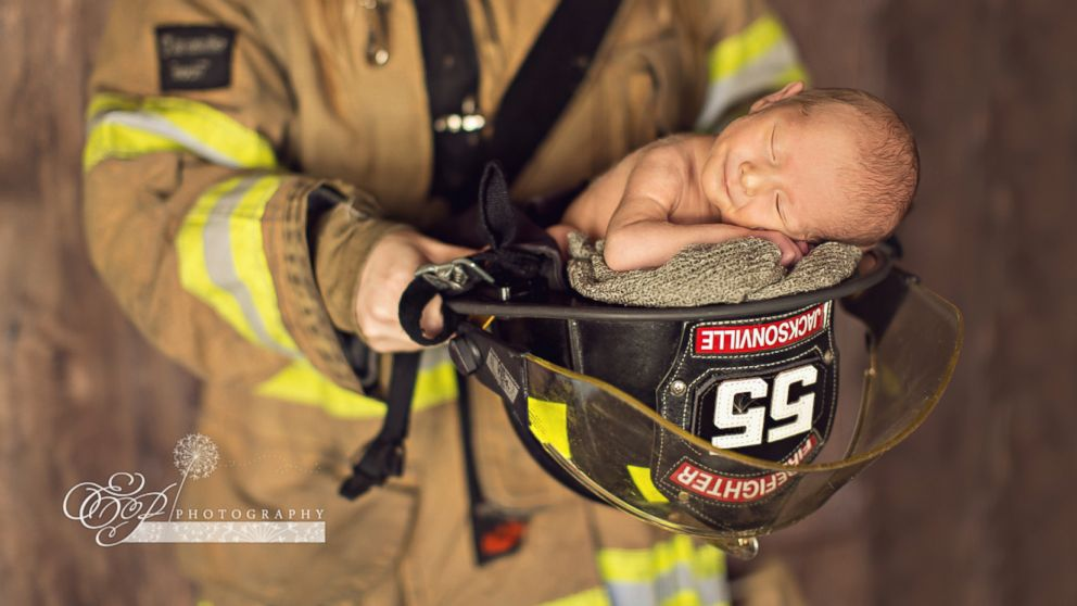 Enzo Anthony Crnolic, 1 month, posed for a newborn photo shoot with his mom's firefighter hat and his dad's police cap.