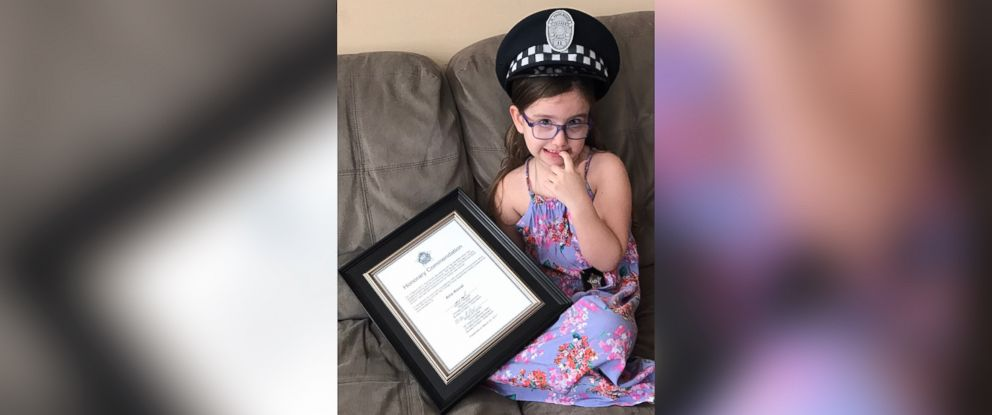 PHOTO: Aria Koval, 4, with the citation that she was given by the Chicago police department on March 22, 2017, for dialing emergency on March 10, 2017 after her mother, Sue Koval, suffered a severe asthma attack at their home in Chicago, Illinois.