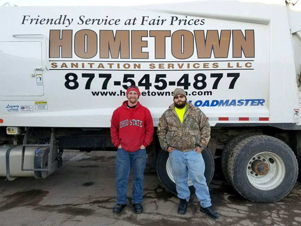 PHOTO: Brandon Olsen and Taylor Fritz of Hometown Sanitation Services seen in this photo on Dec. 29, 2016.