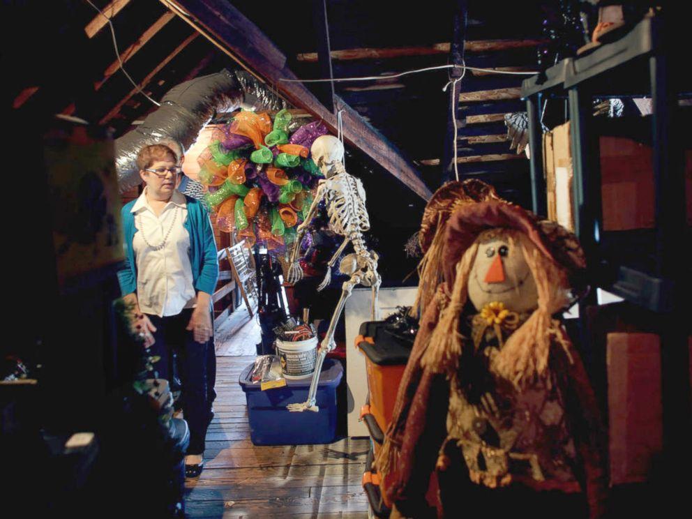 PHOTO: Debbie Strickland, of Suffolk, Virginia, shows off her vast Halloween decorations in her attic.