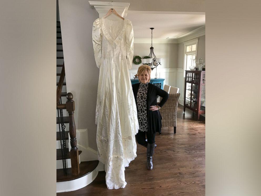 PHOTO: Kim Jones, 52, of Acworth, Georgia, poses with the wedding dress of Shannon McNamara.