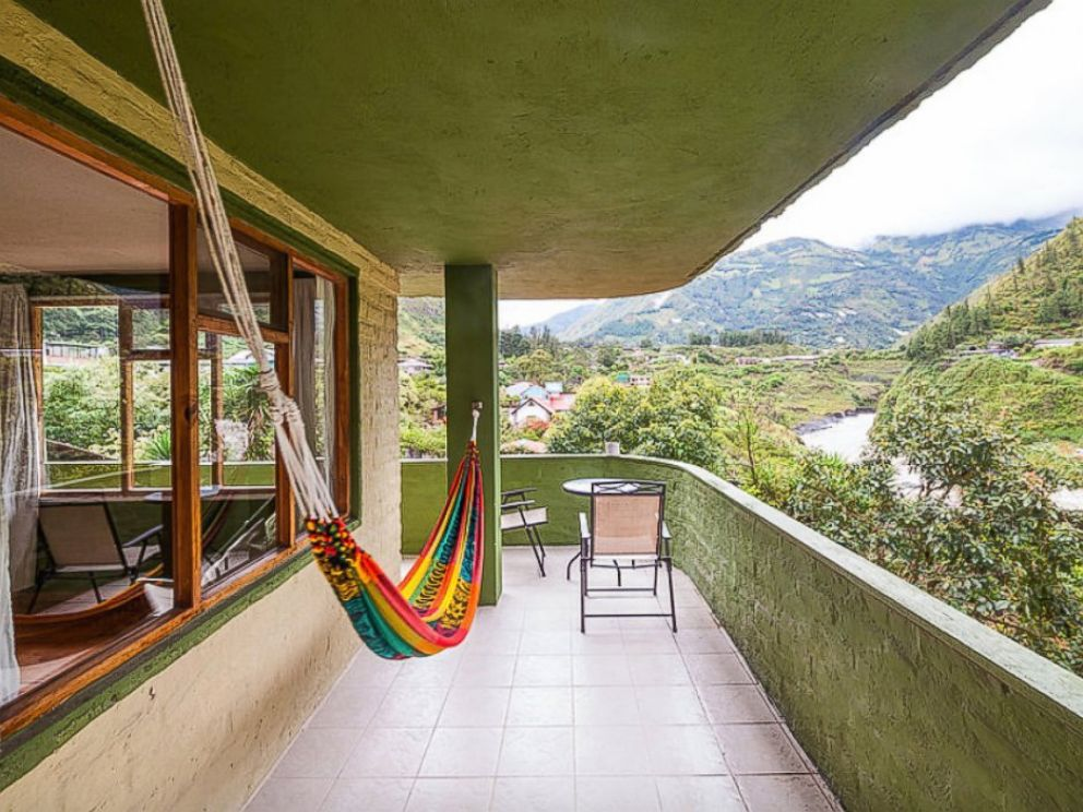 PHOTO: The second floor balcony of La Casa Verde overlooks the surrounding hills of Ecuador.