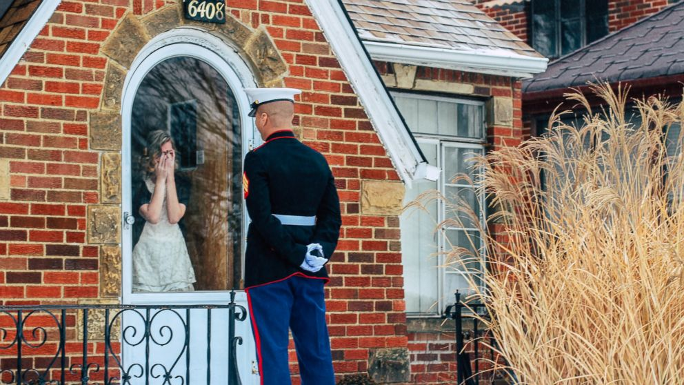Jon Trommer, a Marine, surprised his girlfriend by popping the question on her snowy doorstep.