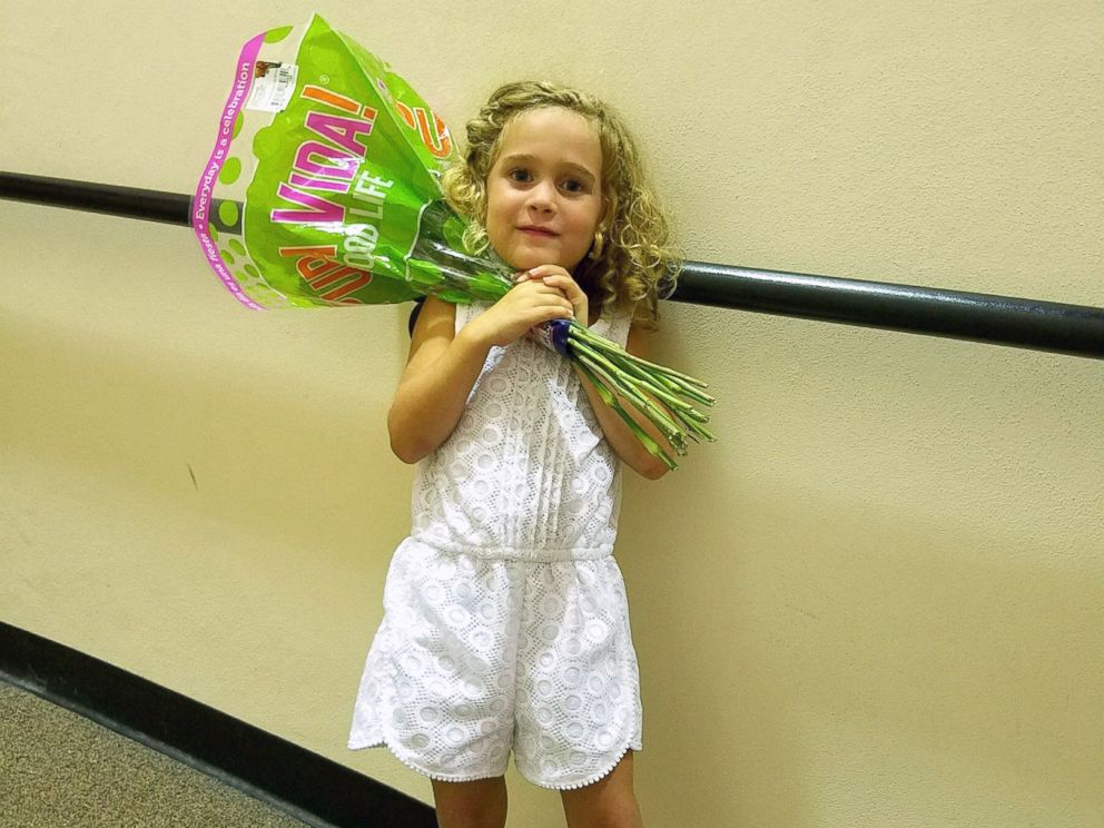 PHOTO: Little Sophia, 4, celebrates with flowers after her extremely passionate performance at her graduation ceremony.