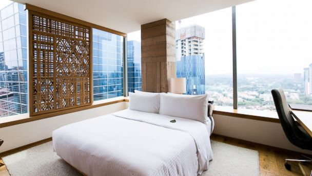 PHOTO: Oasa Hotels suites on the 22nd floor offer panoramic views of Singapore and luxurious accommodations.