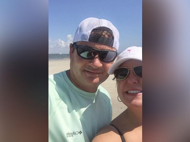 PHOTO: Ryan Burchett posing with his girlfriend on the beach five minutes before discovering the bottle.