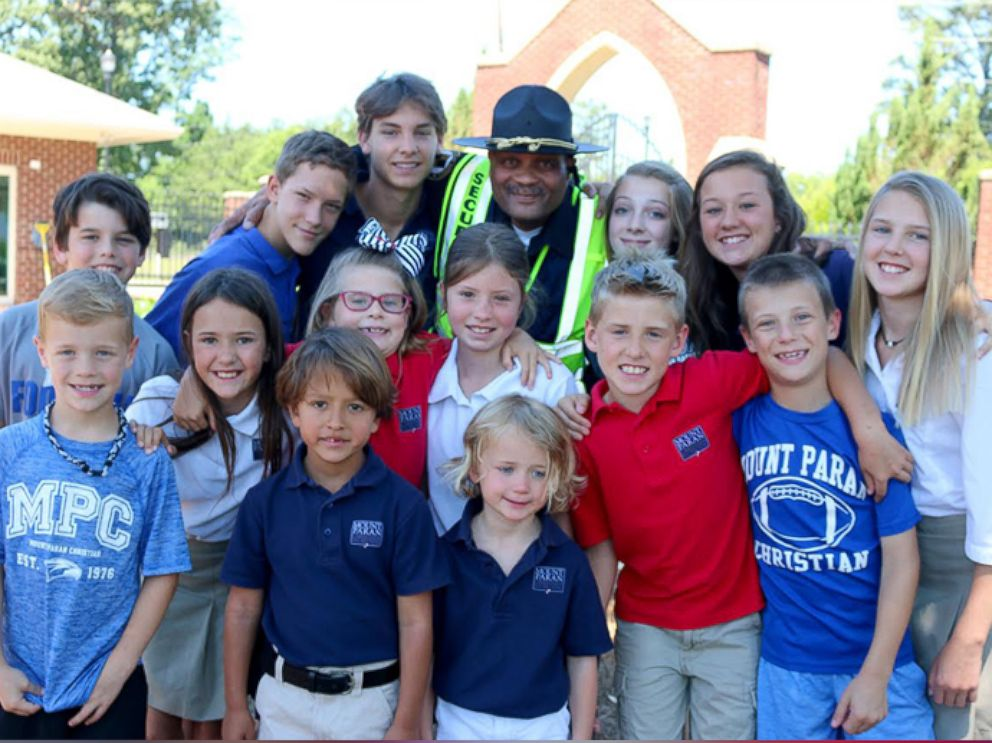 PHOTO: Jonathan Broadnax, the security guard at Mount Paran Christian School, was bombarded with hugs from students on the last day of school.