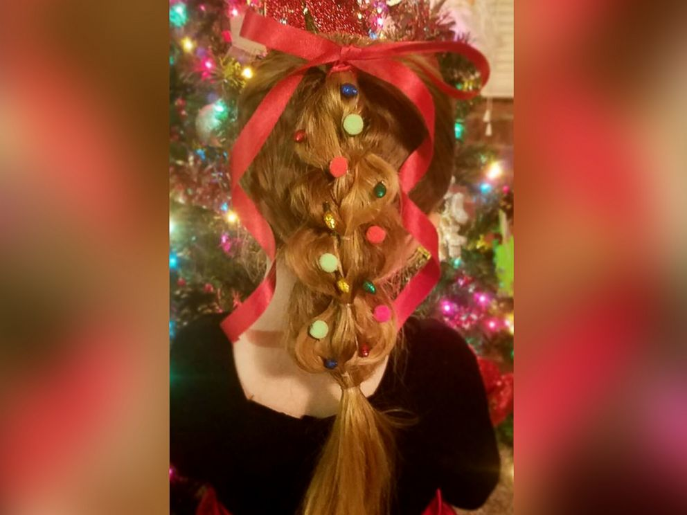 PHOTO: Greg Wickherst styles his daughter Izzys hair for Christmas. This is the pull through tree.