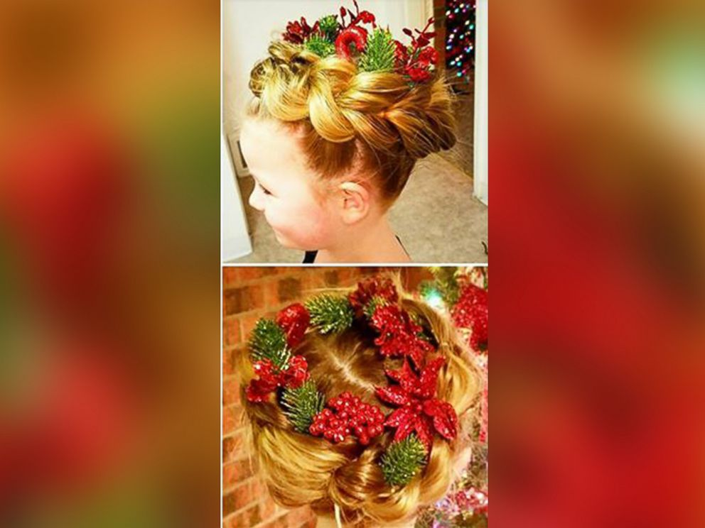 PHOTO: Greg Wickherst styles his daughter Izzys hair for Christmas. This is the Wreath design.