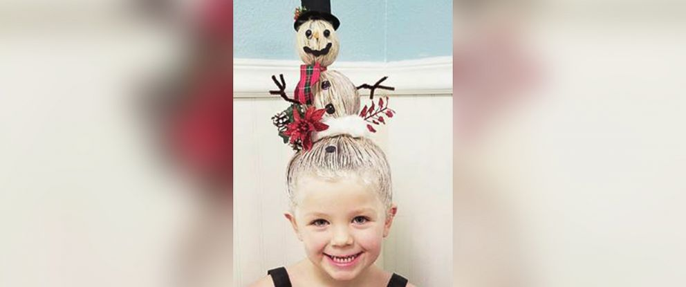 PHOTO: Greg Wickherst styles his daughter Izzys hair for Christmas. This is the Snowman.