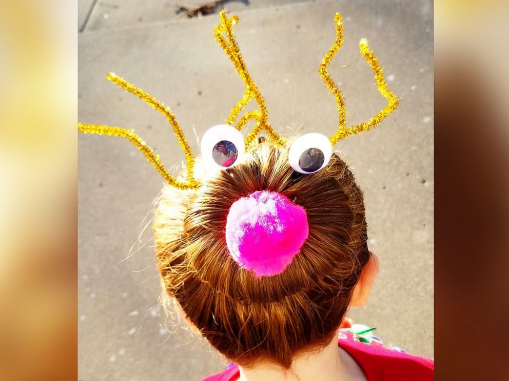 PHOTO: Greg Wickherst styles his daughter Izzys hair for Christmas. This is the Rudolph bun.