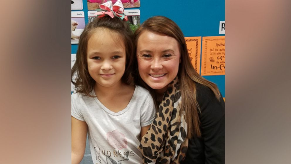 Abby Henderson, an 8-year-old second grader at Southview Primary School, with her teacher, Tori Gooden.