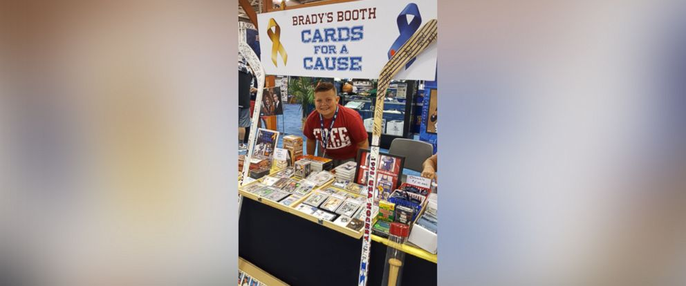 PHOTO: Brady Kahle of Springfield, Massachusetts, sells his baseball card collection to raise money for two friends who have cancer.