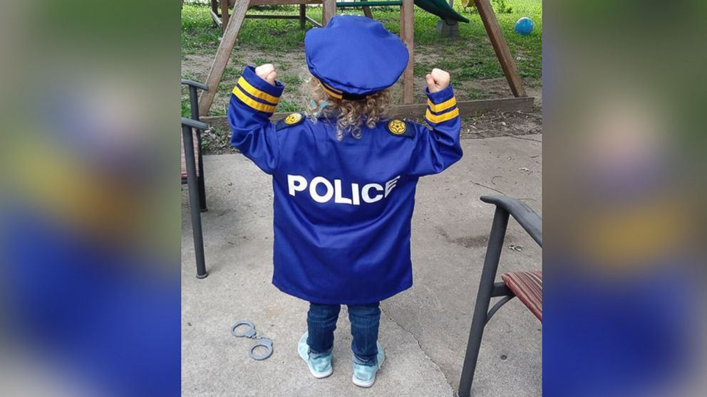 Hannah Pasley, 3, was visited by dozens of police officers at a lemonade stand in front of her Kansas City, Missouri, home.