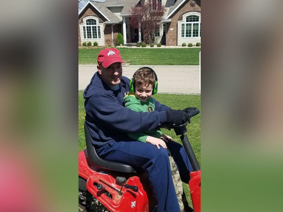 PHOTO: Brian Kelly, 5, rides with his dad, Dan Kelly, on the lawnmower before Kellys deployment.