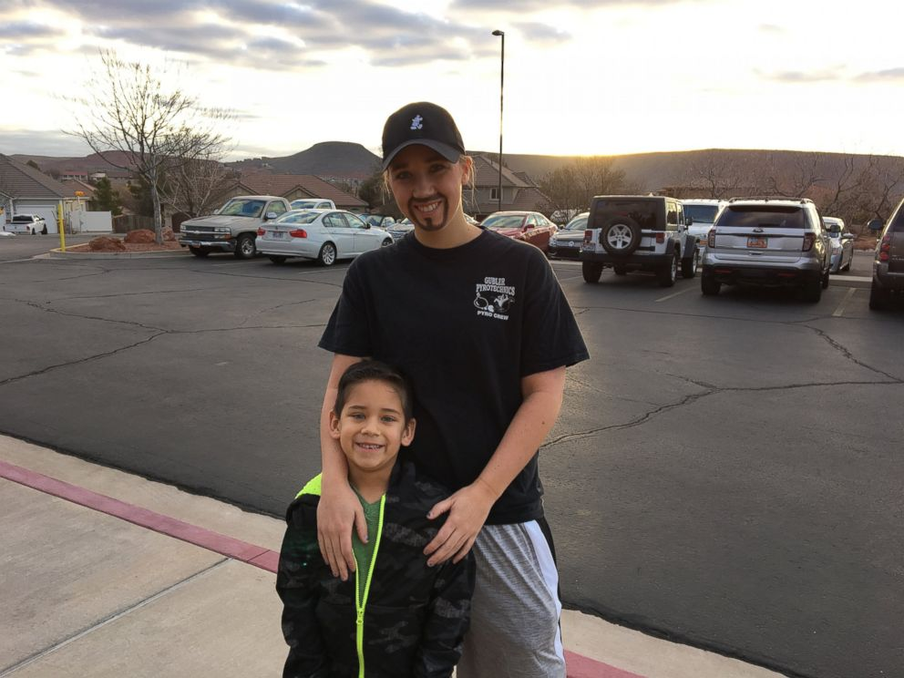 PHOTO: Whitney Kittrell of St. George, Utah, dresses as a dad for her son Lucas, 5, at his schools PTA-sponsored event during Family Week on Feb. 8.