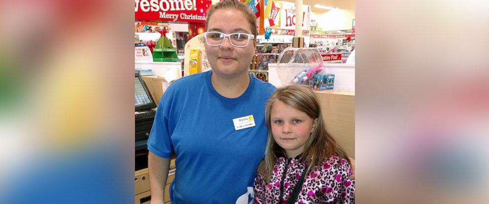 PHOTO: Sheilla Nelson, 17, photographed with Violet Provencher, 8, at a Toys R Us in Manchester, N.H. on Black Friday.