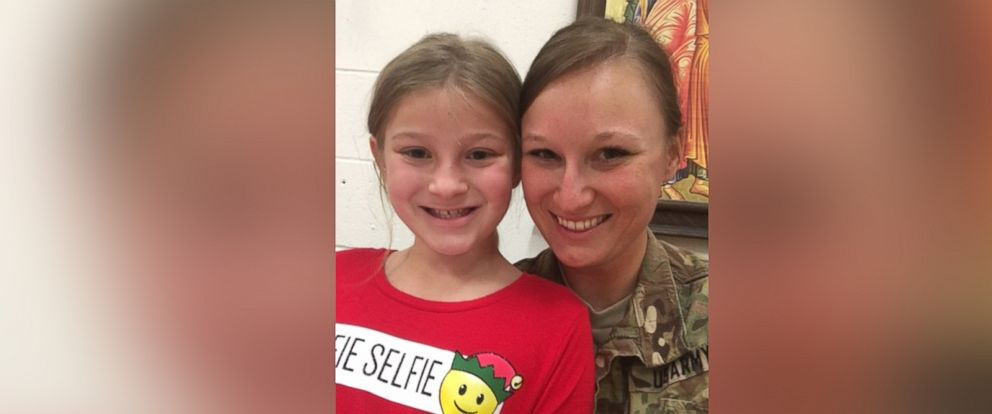 PHOTO: Christine Rainey, a specialist in the Army, returned home from her deployment in Qatar to surprise her daughter and her dance recital.