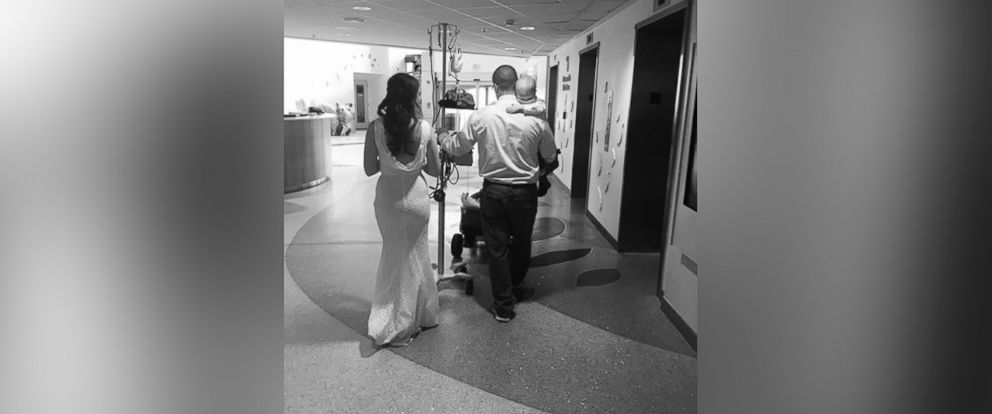 PHOTO: A candid photo taken by Megan Dempsey, 49, of her daughter Celia Kinzel and son-in-law Geff Kinzel, carrying their son Logan after their wedding ceremony.