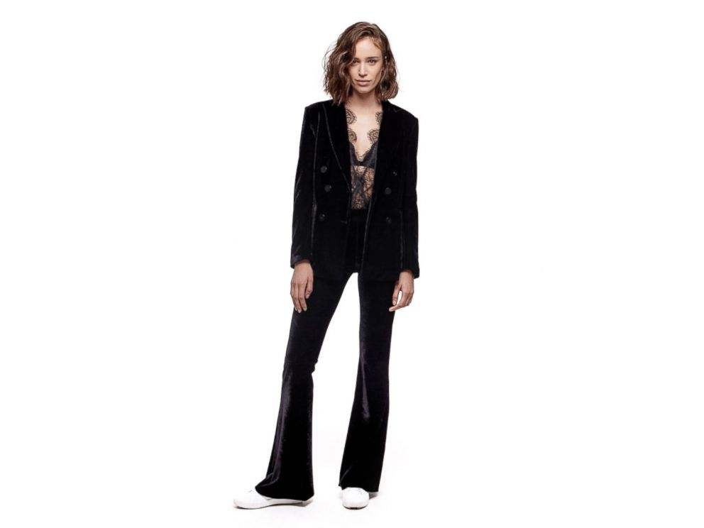 PHOTO: A model wears a velvet blazer and flare pant from Zendayas new fashion line.