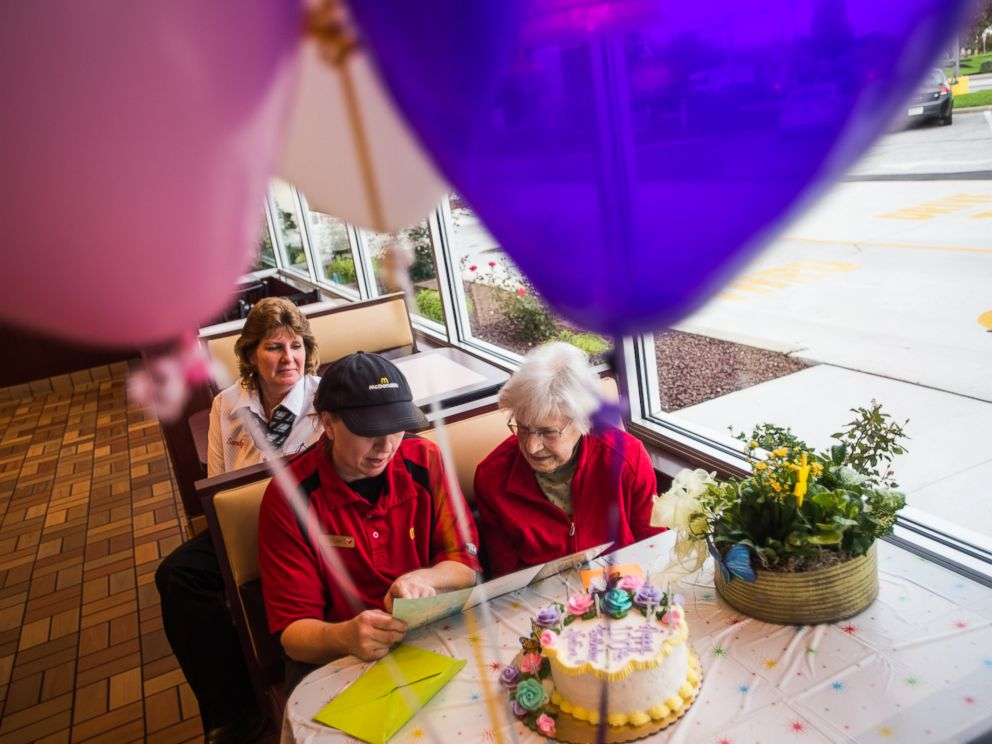 PHOTO: Nadine Baum reads a birthday card with McDonalds employee Kim Birgensmith and manager Sandy Arentz, background, Oct. 13, 2016 at the south Hanover McDonalds.