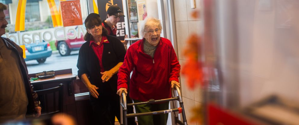 PHOTO: Nadine Baum reacts while entering McDonalds, Oct. 13, 2016, in south Hanover with her son, Mike Baum, when she sees a surprise birthday party for her 100th birthday organized by the staff of the restaurants.