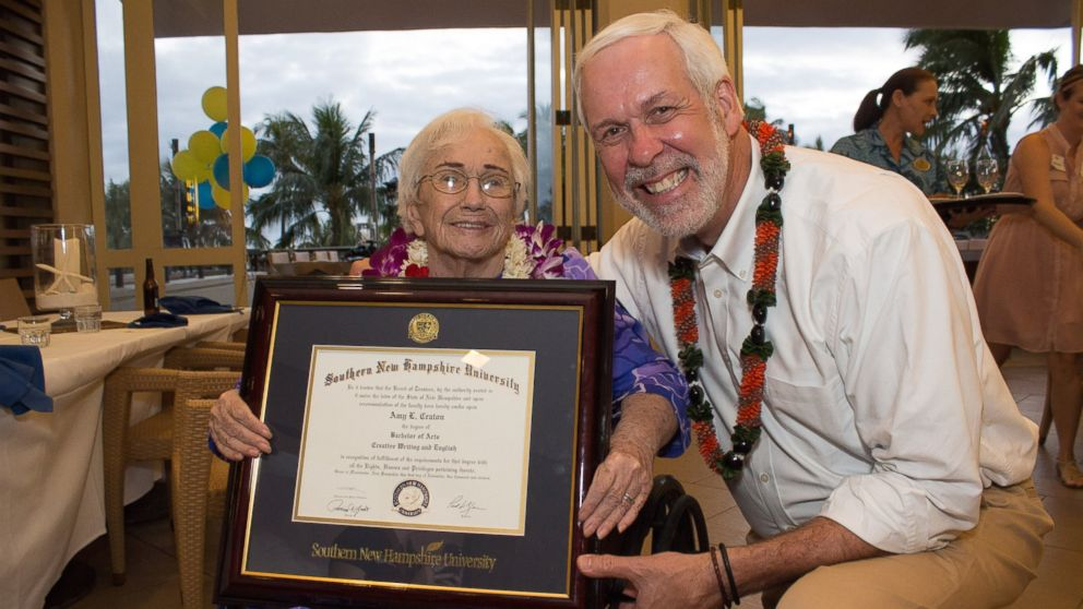 Amy Craton, a 94-year-old graduate of Southern New Hampshire University, with the school's president, Paul LeBlanc.