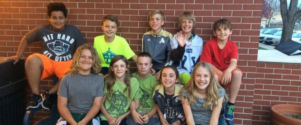 PHOTO: Brady Green, seated in center of photo,with the friends who stood in front of the Poudre School District school board to advocate for his acceptance into the middle school they will attend next year.