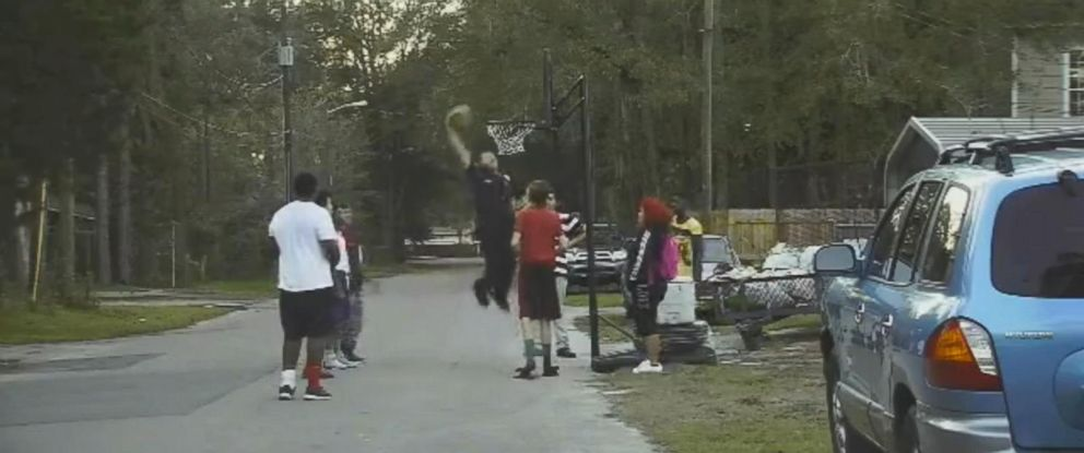 PHOTO: Gainesville Police Officer Bobby White answered a complaint on Jan.15 about kids playing in the street and ended up joining them in a pickup basketball game.