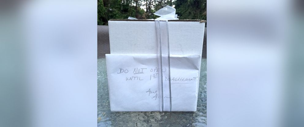"PHOTO:Kathy and Brandon Gunn of Northville, Michigan waited 9 years to open a present that was given to them on their wedding day, September 1, 2007. The envelope attached to the white box read, ""Do Not Open Until 1st Disagreement."""