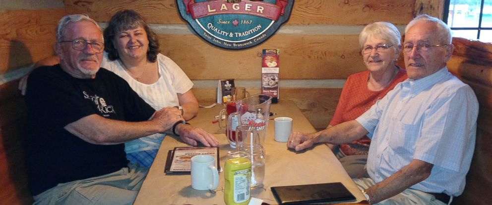 PHOTO: Terri Ward (back left), Gordon Cameron (front left), and Pauline and Glenn Ward caught up over a meal at Montanas Cookhouse during Camerons visit to Moncton, New Brunswick.