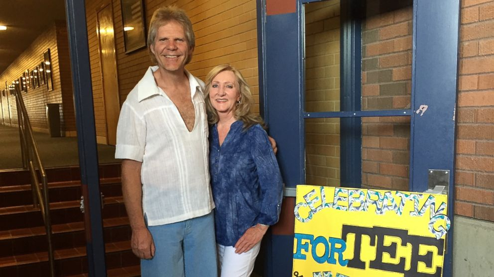 Roger Hepworth, 58, of Ogden, Utah, poses with his high school date at their 40th high school reunion.