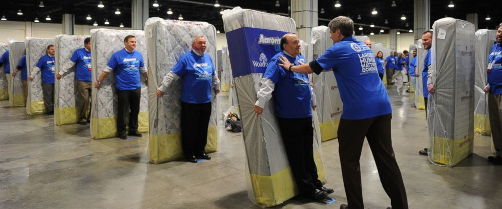 PHOTO: Aarons Inc. broke the Guinness World Record for largest human mattress domino in March.