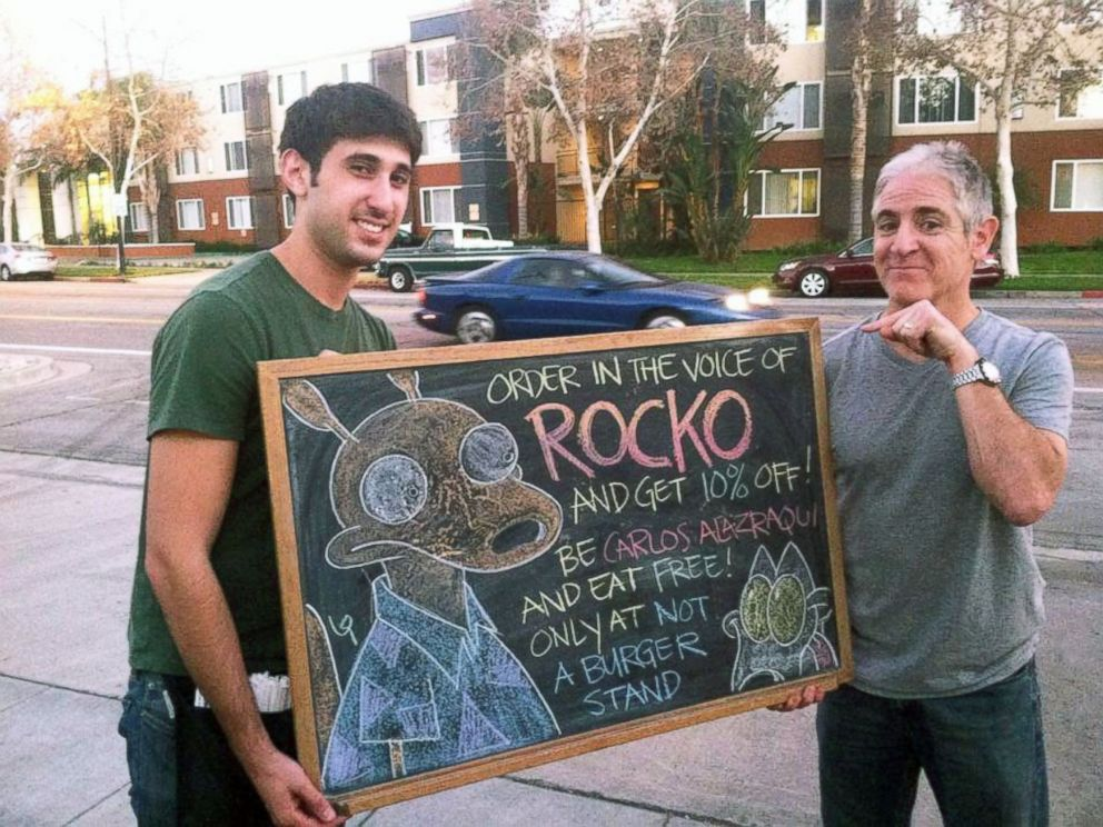 PHOTO: California restaurant Not a Burger stand owner Matt Peek with Carlos Alazraqui (Rocko from Rockos Modern Life).