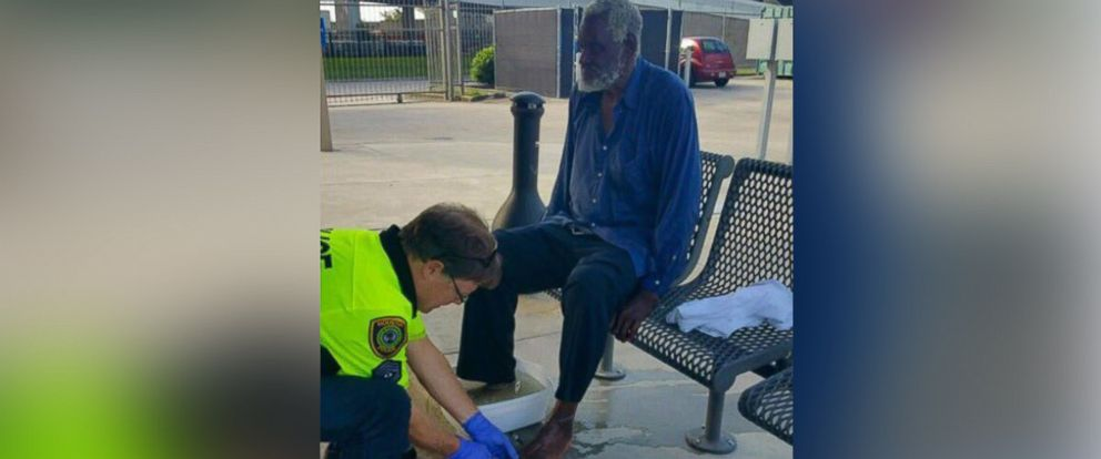 PHOTO: Sergeant Steve Wick of the Houston Police Department seen with a homeless man named Quintus, cleaning his feet and clipping his toe nails.