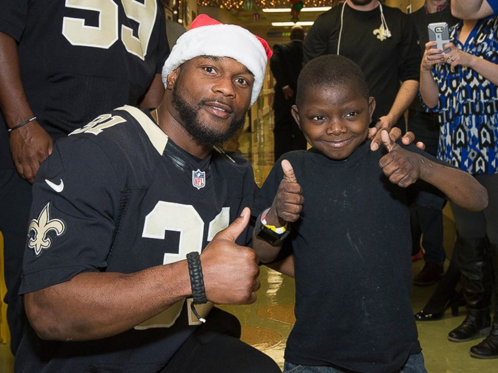PHOTO: New Orleans Saints super fan Jarrius Robertson, 14, is living with chronic liver disease.