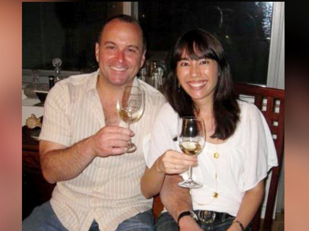 PHOTO: Vinotas Selections owner Michel Robert Abood sits with his wife and chief operating officer Veronica Moreno as they enjoy a glass of organic wine.
